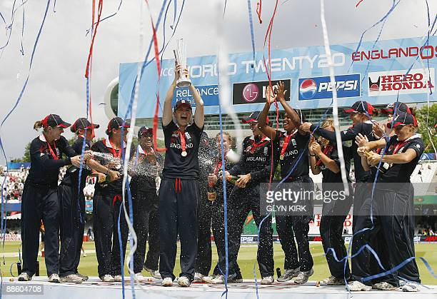 Charlotte Edwards of England lifts the trophy with her team after winning the women's final of the ICC Twenty20 Cricket World Cup against New Zealand...