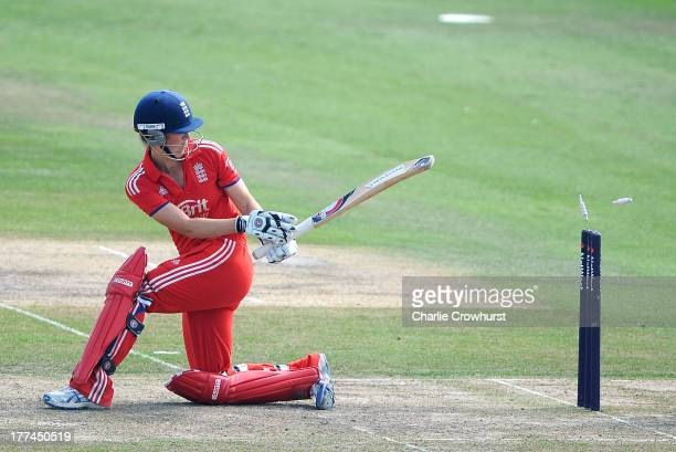 Charlotte Edwards of England looks at the wicket after being bowled out by Australia's Jessica Jonassen during the England Women and Australia Women...