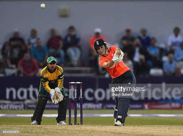Charlotte Edwards of England plays a shot as South Africa wicketkeeper Trisha Ghetty looks on of South Africa during the NatWest Women's...