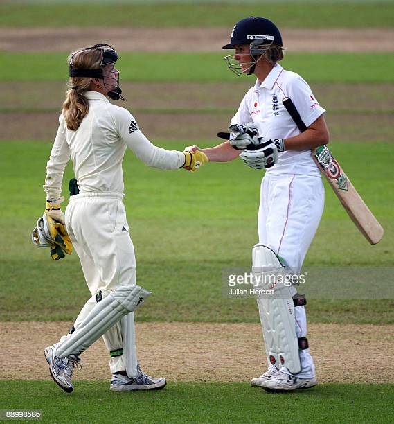 Charlotte Edwards of England shakes hands with her counterpart Jodie Fields after the draw on the 4th day of England Women v Australia Women 1st Test...