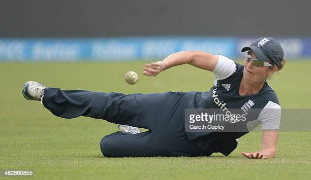 Charlotte Edwards of England takes part in a fielding drill during a nets session at ShereBangla Mirpur Stadium on April 5 2014 in Dhaka Bangladesh