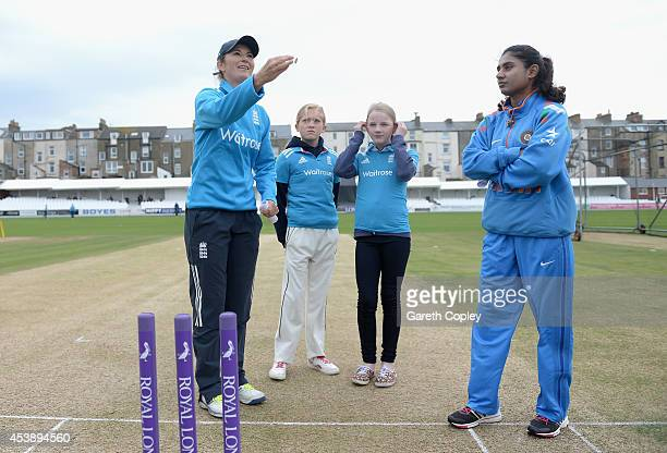 Charlotte Edwards of England tosses the coin alongside Mithali Raj of India ahead of the 1st Royal London ODI between England and India at North...