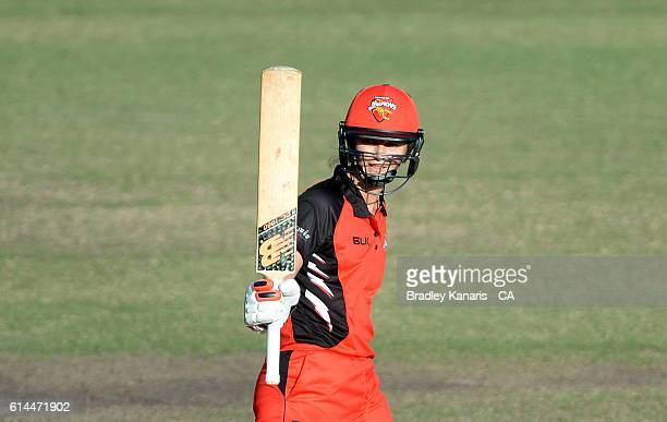 Charlotte Edwards of South Australia celebrates scoring a century during the WNCL match between Queensland and South Australia at Allan Border Field...
