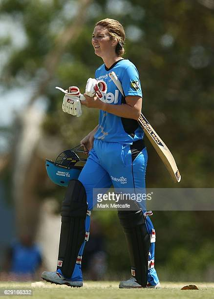 Charlotte Edwards of the Strikers walks from the field after being runout by Sophie Molineux of the Renegades during the Women's Big Bash League...