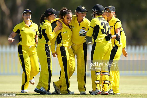 Charlotte Edwards of Western Australia congratulates Emma King after taking a wicket during the WT20 match between Western Australia and Queensland...