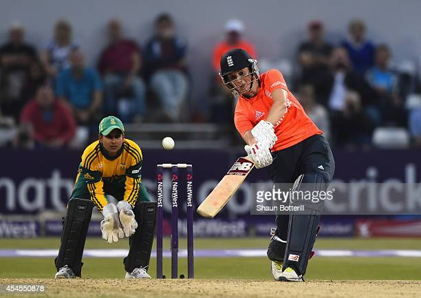 Charlotte Edwards plays a shot as South Africa wicketkeeper Trisha Ghetty looks on of South Africa during the NatWest Women's International T20 match...