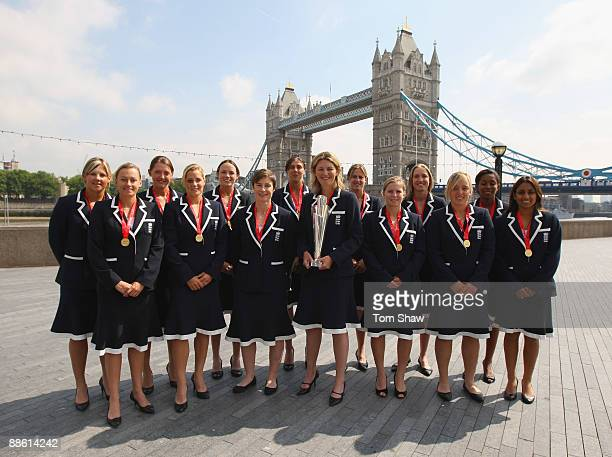 Charlotte Edwards the England captain holds the trophy with the rest of the England Women's Cricket team in front of Tower Bridge at City Hall on...