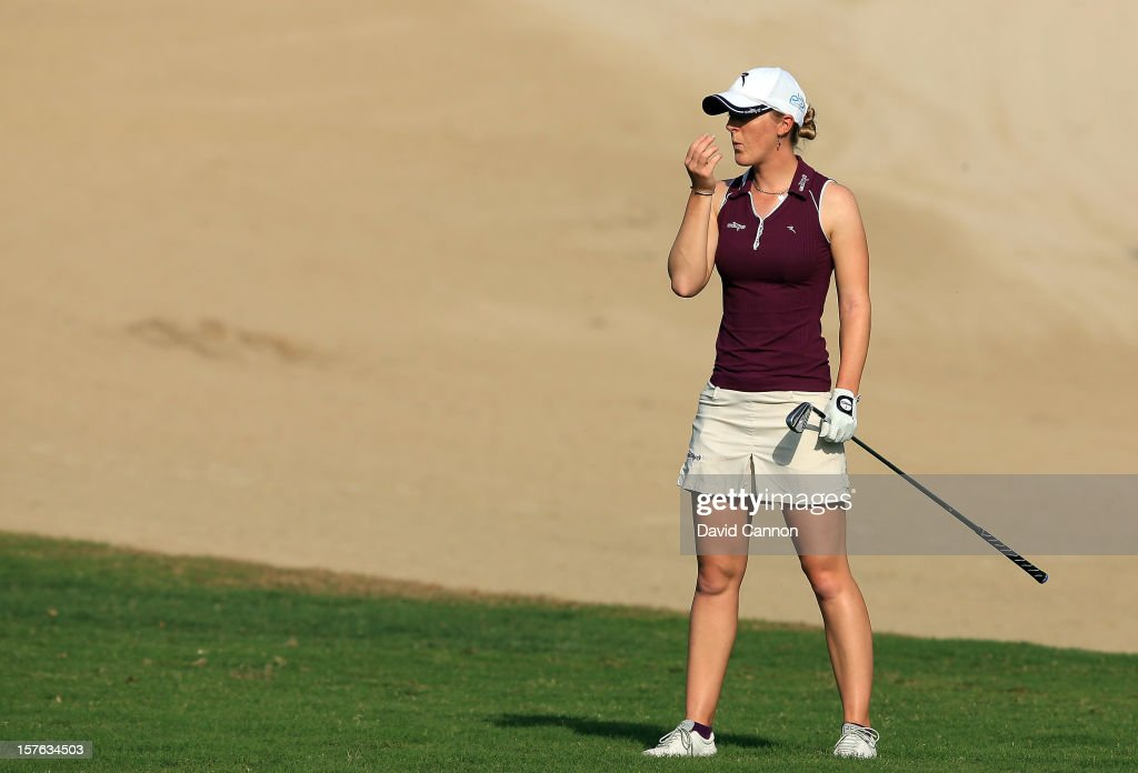 Charlotte Ellis of England plays her second shot at the par 4, 14th hole during the first round of the 2012 Omega Dubai Ladies Masters on the Majilis Course at the Emirates Golf Club on December 5, 2012 in Dubai, United Arab Emirates.