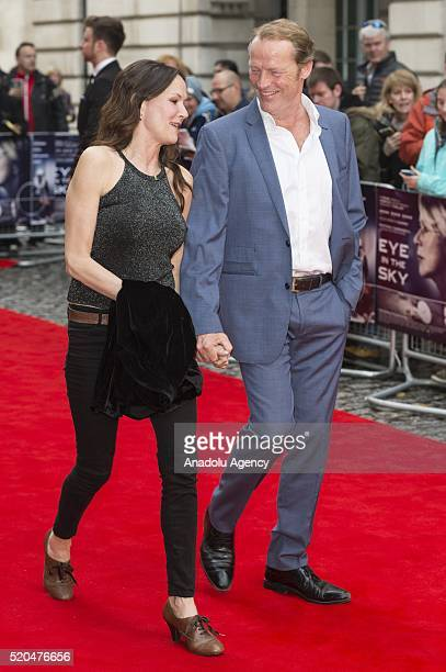 Charlotte Emmerson and Iain Glen attend the European film premiere of Eye In The Sky on April 11 2016 in London United Kingdom