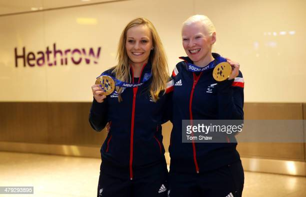 Charlotte Evans and Kelly Gallacher of Great Britain show off their Gold medal during the ParalympicsGB Welcome Home Press Conference at Heathrow...