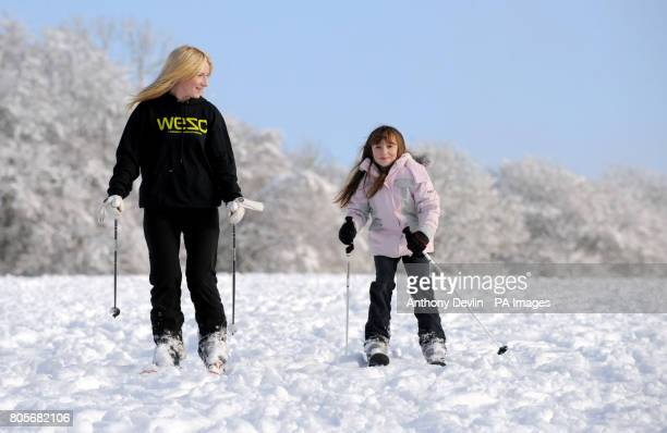 Charlotte Fensome and daughter Georgia Fensome ski down a hill following overnight snowfall in Basingstoke, Hampshire.