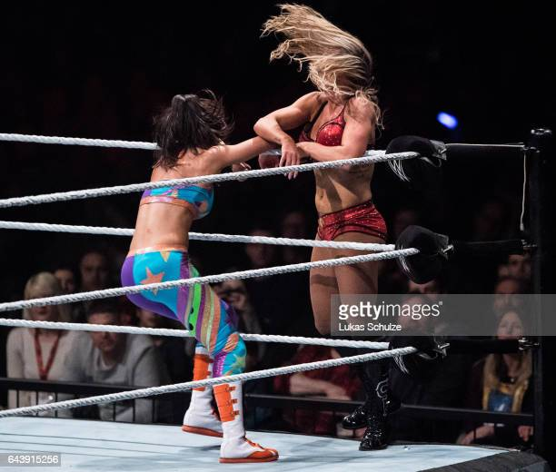 Charlotte Flair and Bayley fight during to the WWE Live Duesseldorf event at ISS Dome on February 22 2017 in Duesseldorf Germany
