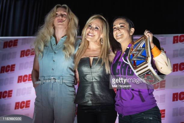 Charlotte Flair Lilian Garcia and Bayley of WWE pose for a photo during ACE Comic Con at Century Link Field Event Center on June 28 2019 in Seattle...
