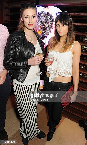 Charlotte Flyvholm and Lila Parsons attend Christian Furr and Chris Bracey 'Staying Alive' Private View at 45 Park Lane on July 3 2013 in London...