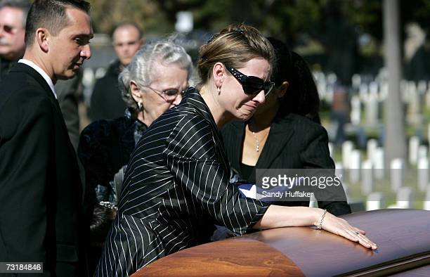 Charlotte Freeman touches the coffin of her husband Capt Brian Freeman during a memorial service at Ft Rosecrans National Cemetery on February 2 2007...