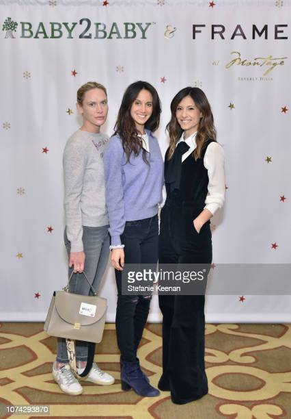 Charlotte Freund Ali Kay and Norah Weinstein attend the Baby2Baby Holiday Party Presented by FRAME at Montage Beverly Hills on December 16 2018 in...