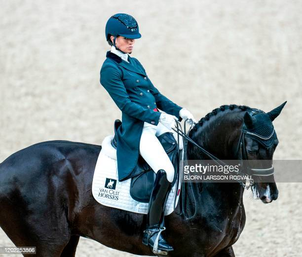 Charlotte Fry of Great Britain competes with the horse Dark Legend to place second in the FEI Dressage World Cup Grand Prix during Gothenburg Horse...