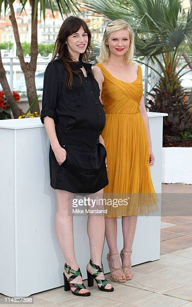 Charlotte Gainsbourg and Kirsten Dunst attend the 'Melancholia' Photocall during the 64th Cannes Film Festival at the Palais des Festivals on May 18...