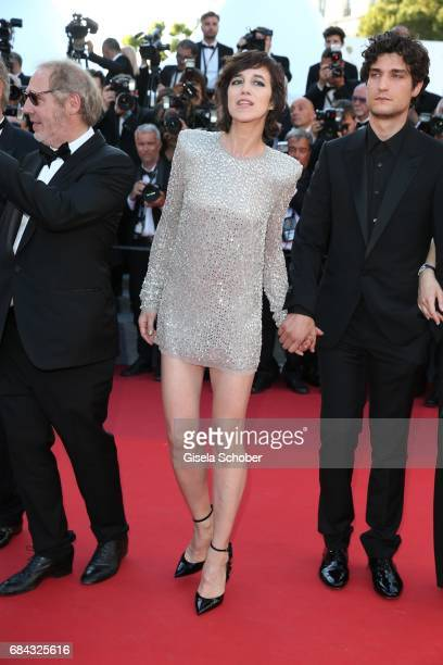 Charlotte Gainsbourg and Louis Garrell attend the 'Ismael's Ghosts ' screening and Opening Gala during the 70th annual Cannes Film Festival at Palais...