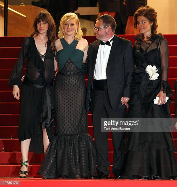 Charlotte Gainsbourg Kirsten Dunst Director Lars von Trier and Bente Froge attend the Melancholia Premiere during the 64th Cannes Film Festival at...