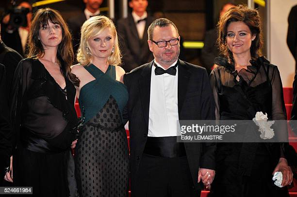 Charlotte Gainsbourg Kirsten Dunst Director Lars von Trier and Bente Froge at the premiere of Melancholia during the 64th Cannes International Film...