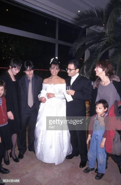 Charlotte Gainsbourg, Yvan Attal et Jane Birkin au mariage de Jocya Macias avec Oury Milshtein le 9 février 1992 à Paris, France.