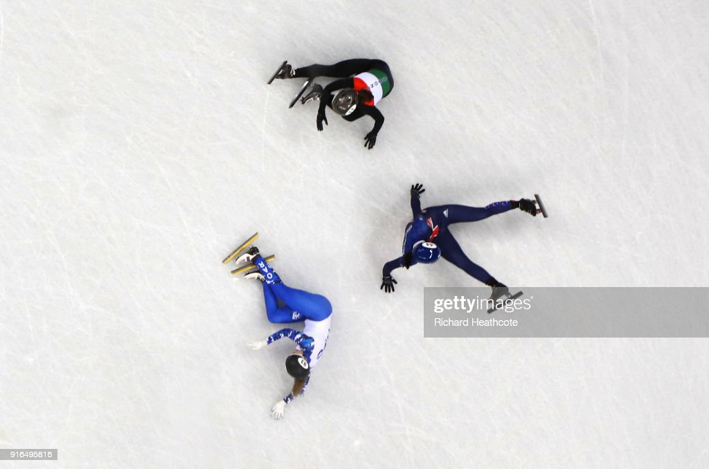 Charlotte Gilmartin of Great Britain, Olympic Ahtlete from Russia Emina Malagich and Petra Jaszapati of Hungary collide during the Ladies' 500m Short Track Speed Skating qualifying on day one of the PyeongChang 2018 Winter Olympic Games at Gangneung Ice Arena on February 10, 2018 in Gangneung, South Korea.