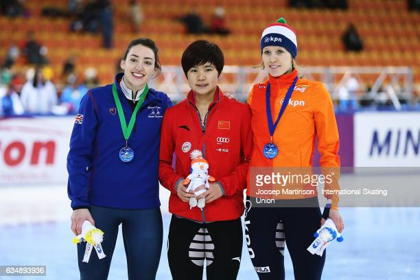 Charlotte Gilmartin of Great Britain Yutong Han of China and Rianne de Vries of Netherlands pose in the Ladies 1000m medal ceremony during day two of...