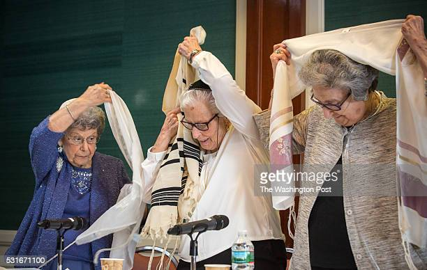 Charlotte Gottlieb Charlotte Markowitz and Sy Laufe place a Tallit, a Jewish prayer shawl over their shoulders, before they are called to the Torah...