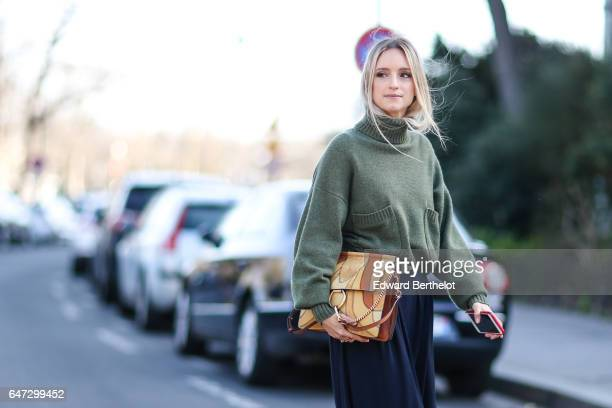 Charlotte Groeneveld fashion blogger from the Fashion Guitar wears a green pull over a Chloe bag and a blue skirt outside the Chloe show during Paris...
