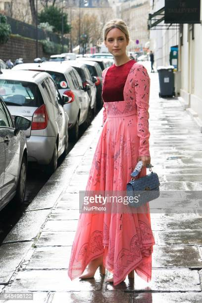 Charlotte Groeneveld fashion blogger from The Fashion Guitar wears a pink lace dress a bag and pink leather boots outside the Valentino show during...