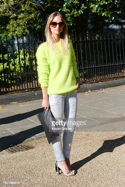 Charlotte Groeneveld fashion blogger, wearing Alexander Wang shoes, Givenchy clutch bag, Supet Trash trousers, Acne sweater and Prada sunglasses on...