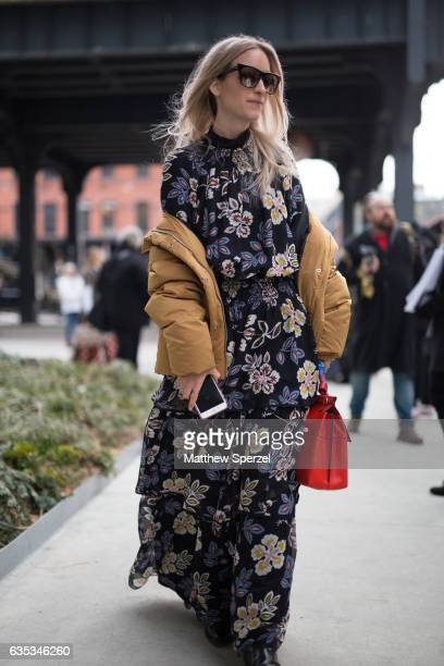 Charlotte Groeneveld is seen attending Tory Burch during New York Fashion Week wearing a floral print dress with tan coat on February 14 2017 in New...