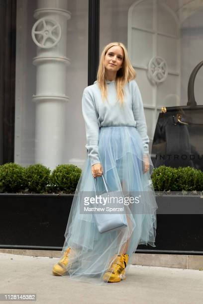 Charlotte Groeneveld is seen on the street during New York Fashion Week AW19 wearing blue sweater with blue tulle skirt and blue bag with yellow high...