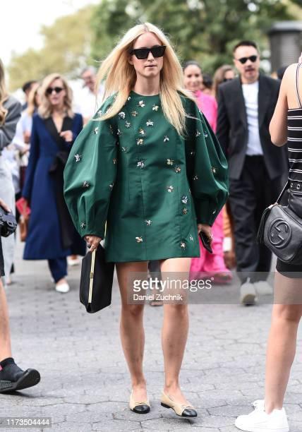 Charlotte Groeneveld is seen wearing a Carolina Herrera green dress and black purse outside the Carolina Herrera show during New York Fashion Week...