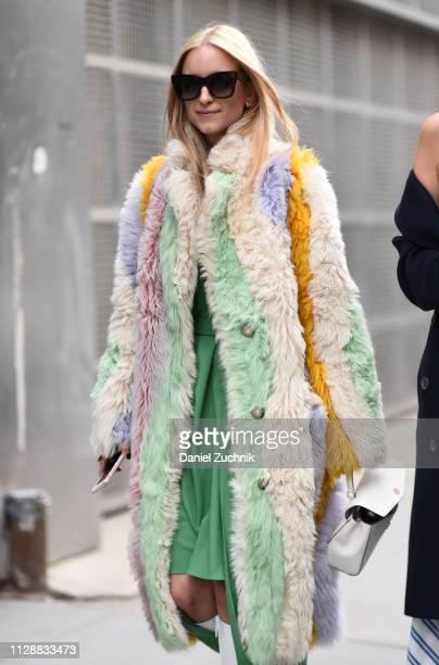 Charlotte Groeneveld is seen wearing a Tibi fur coat and dress outside the Tibi show during New York Fashion Week Fall/Winter 2019 on February 10...