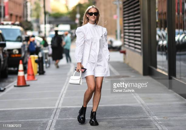 Charlotte Groeneveld is seen wearing a white dress and bag outside the R13 show during New York Fashion Week S/S20 on September 07, 2019 in New York...