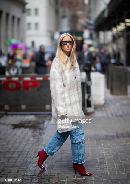 Charlotte Groeneveld is seen wearing denim jeans, plaid coat, white bag outside Michael Kors during New York Fashion Week Autumn Winter 2019 on...