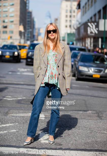 Charlotte Groeneveld is seen wearing denim jeans top with floral print blazer outside Brock Collection during New York Fashion Week Fall / Winter on...