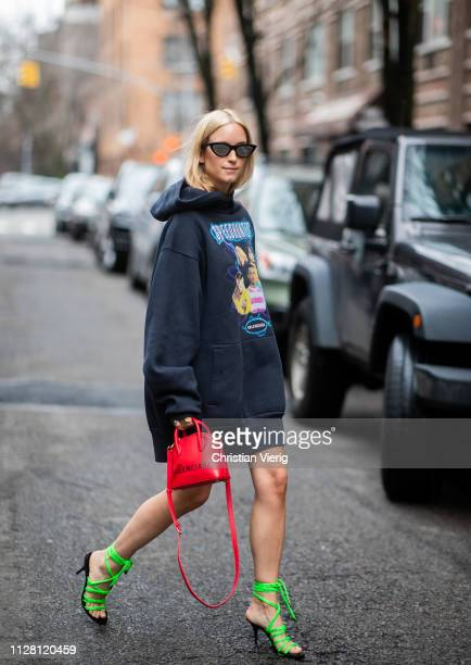 Charlotte Groeneveld is seen wearing oversized hoody laced heels red Balenciaga bag outside Collina Strada during New York Fashion Week Autumn Winter...