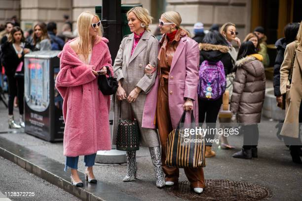 Charlotte Groeneveld is seen wearing pink teddy coat Mary Lawless Lee and a guest wearing brown leather pants outside Kate Spade during New York...