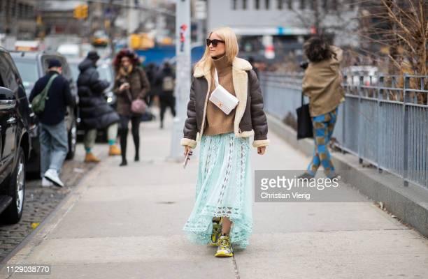 Charlotte Groeneveld is seen wearing shearling jacket, mint skirt, brown turtleneck outside Zimmermann during New York Fashion Week Autumn Winter...