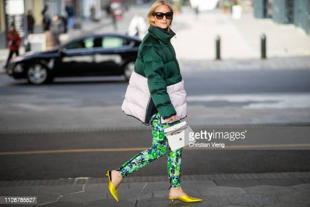 Charlotte Groeneveld is seen wearing two tone puffer jacket pants with floral print white bag outside Tory Burch during New York Fashion Week Autumn...