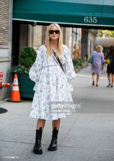 Charlotte Groeneveld is seen wearing white dress with print, black bag, boots outside Marc Jacobs during New York Fashion Week September 2019 on...