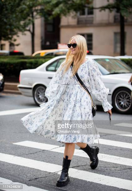 Charlotte Groeneveld is seen wearing white dress with print black bag boots outside Marc Jacobs during New York Fashion Week September 2019 on...