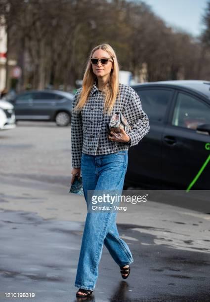 Charlotte Groeneveld is seen wearing wide leg denim jeans, cropped jacket outside Chanel during Paris Fashion Week - Womenswear Fall/Winter 2020/2021...