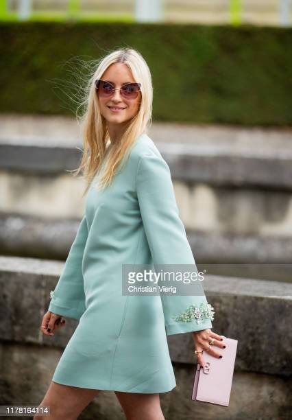Charlotte Groeneveld seen wearing dress with long sleeves, pink clutch outside Valentino during Paris Fashion Week Womenswear Spring Summer 2020 on...