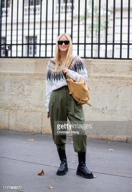 Charlotte Groeneveld seen wearing knit with pattern, brown bag, khaki pants, black boots outside Altuzarra during Paris Fashion Week Womenswear...