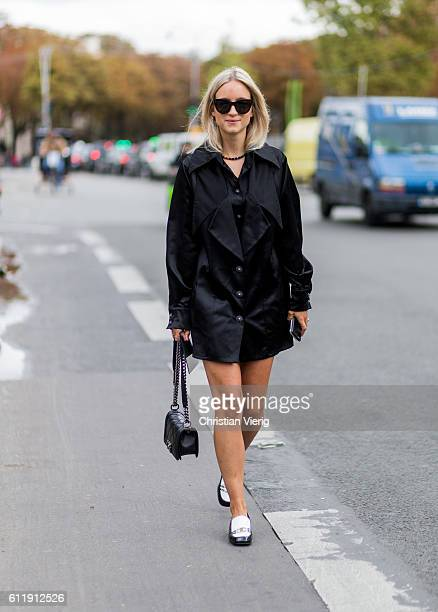 Charlotte Groeneveld wearing a black Chanel dress and bag outside Mugler on October 1 2016 in Paris France
