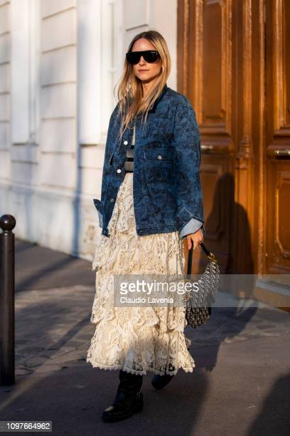 Charlotte Groeneveld, wearing a blue printed jacket, beige maxi skirt, black boots and Dior bag, is seen outside Christian Dior during Paris Fashion...